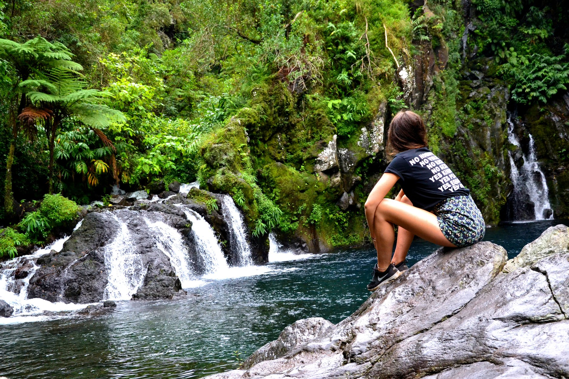 A woman sits on a boulder overlooking waterfalls into a river. She is using the ecospiritual practices to reconnect to the Earth and her sense of deep belonging. If you are looking for guidance on reconnecting and healing with the Earth, please reach out! I am an ecotherapy coach in Berkeley, CA.